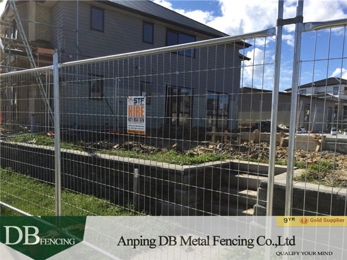 Temporary fence system   installed   around the house site in Auckland