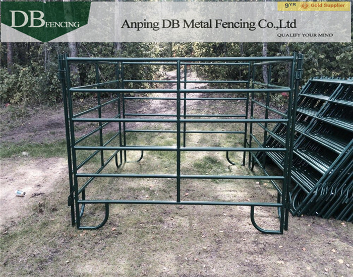 a picture of powder coated green corral panels in the yard