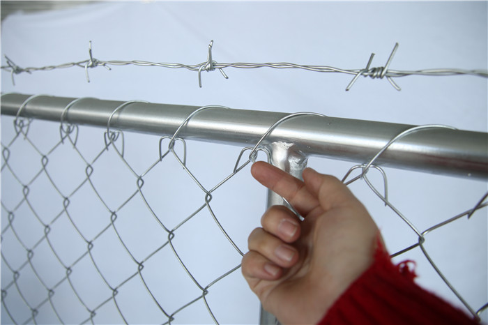 Barbed wire on the temporary chain link fence top side