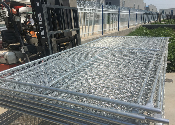 temporary chain link fence loaded into container by fork lift